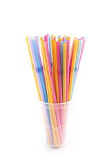 Many straws in plastic glass isolated on white