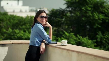 Portrait of happy, successful businesswoman standing on terrace