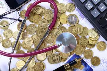 Business composition of stethoscope on the money