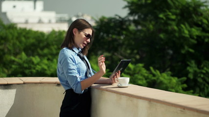Young businesswoman working on tablet computer  on terrace