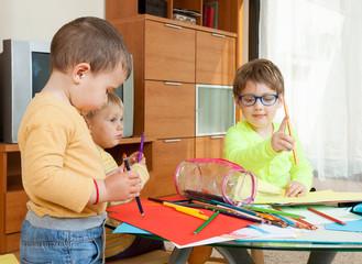 three children   with crayons