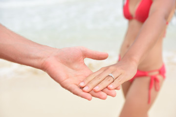 Newlyweds beach wedding concept - closeup of rings