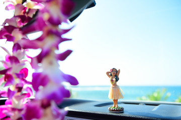 Hawaii travel car - Hula girl dancing and lei