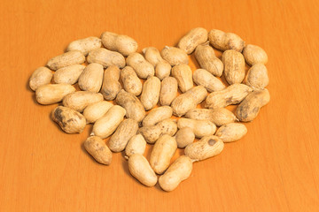 Heart from Dried peanuts on the brown table