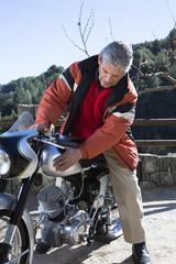 man caressing a motorcycle.