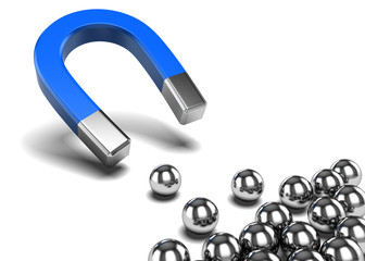 Magnet attracts spheres - business concept - competition concept