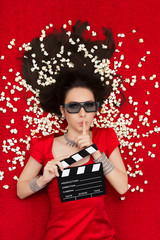 Girl with 3D Glasses,  Popcorn and Clapboard Asking for Silence