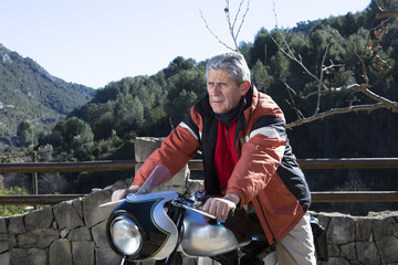 man sitting on a motorbike.