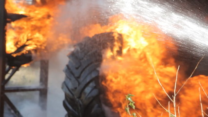 Fireman extinguishes the fire with a water jet