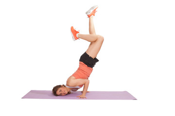 woman doing a headstand - fitness sport exercise - sport