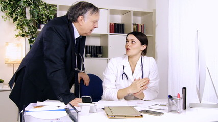 Doctors in studio discussing strong