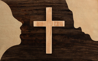 christian couple pray concept cross wooden silhouette paper cut