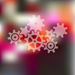 cogwheel icon on blurred background