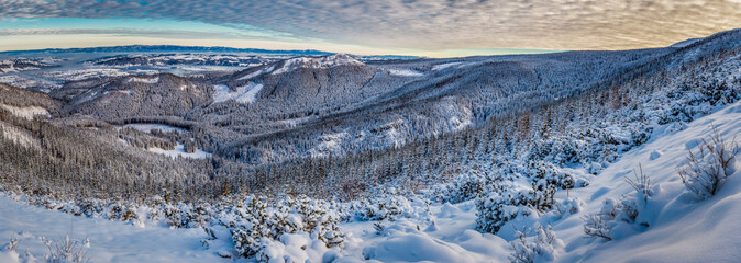 Big panorama of dawn over the mountain valley in winter
