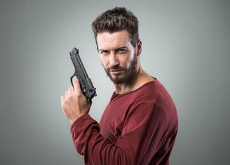 Cool young man holding a gun