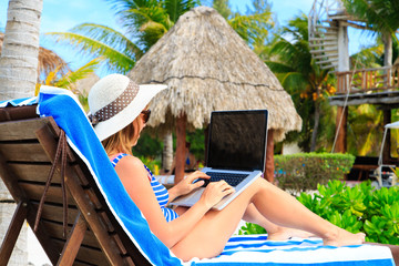 woman with laptop on tropical  vacation
