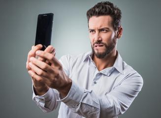 Cool man taking a selfie