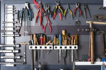 tools on a metal board .