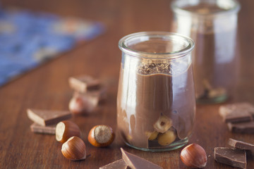 Chocolat cream and hazelnuts over wood