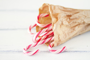 Traditional christmas candy canes on paper bag