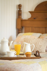Breakfast in bed on a tray. Country style environment. Vintage