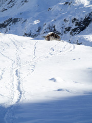 mountain hut in the snow