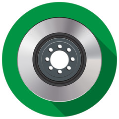 Car brake disc in a flat on a green background