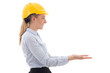side view of business woman in builder helmet holding something