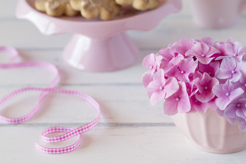 Hydrangea in a bowl, cookies and a pink checkered ribbon.