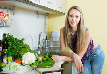 Woman cooking with vegetables