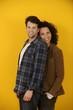 happy couple on yellow background