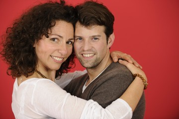 happy couple on red background