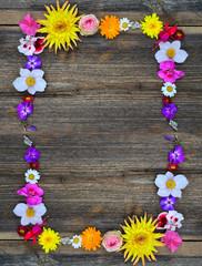 Flowers frame on wood