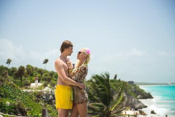 beautiful couple standing near the coast
