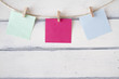 Colorful paper cards hanging on clothespins - 76889530