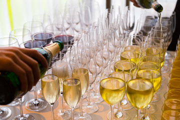 waiters poured into glasses of wine and champagne