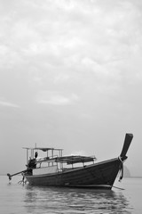 Traditional Thai Fishing Motor Boat on Water in Monochrome