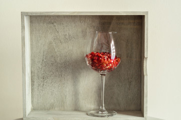 Pomegranate seeds in a glass of wine.