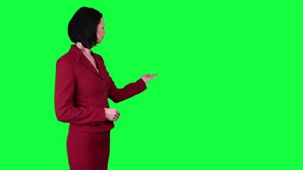 Business woman points somewhere chroma key