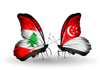 Two butterflies with flags Lebanon and Singapore