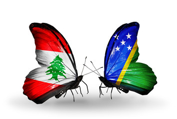 Two butterflies with flags Lebanon and Solomon Islands