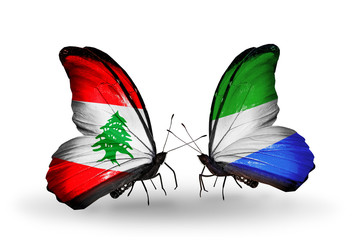 Two butterflies with flags Lebanon and Sierra Leone