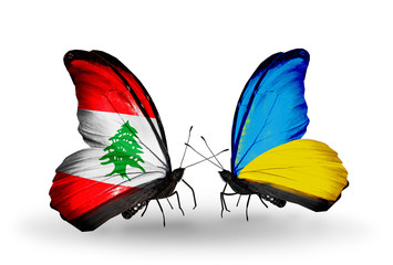 Two butterflies with flags Lebanon and Ukraine