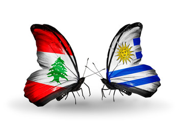Two butterflies with flags Lebanon and Uruguay