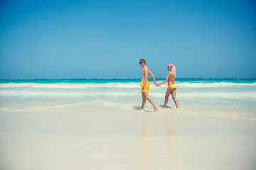 Young couple walking along the seashore