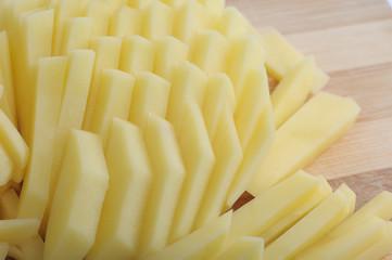 cut julienne potatoes on a cutting board