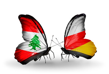 Two butterflies with flags Lebanon and South Ossetia