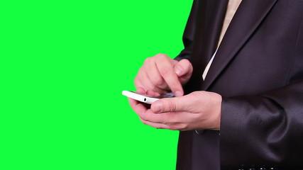 Businessman uses a cell phone chroma key