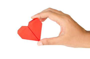 female hand holding paper heart