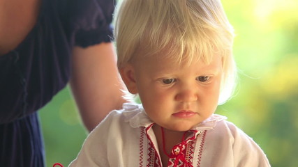 small blonde baby girl in ukrainian national dress vyshyvanka